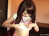 Japanese girl plays with hairy pussy