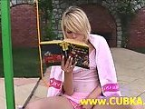Innocent blonde girl dildoing outside