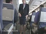 Sexy stew sucking and stroking dick on plane uniform