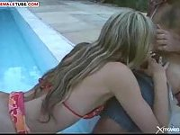 Longhaired tranny by the pool