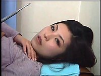 Doctor pets hairy pussy of Japanese brunette