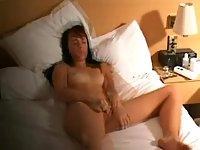 Horny Brunette Slag Pleasing Cunt On A Bed