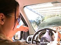 Busty brunette licked in a car