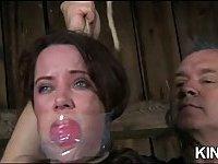Brunette in bondage wet pussy fingered