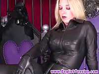 Leatherclad domina rimmed by subject