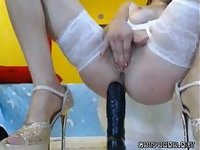 Sexy cam girl in lingerie drills a big dildo