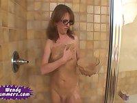 Wendy Summers  jerks her cock in bathroom