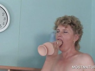 Mature blonde plays with dildo